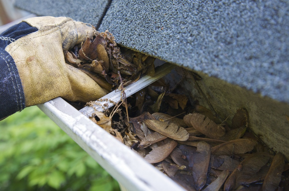 The easiest gutter cleaning method is to start scooping out leaves and other debris by hand.