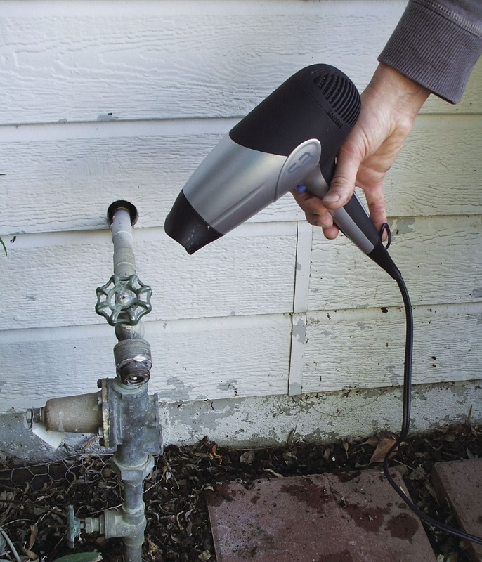 Use a blow dryer to help thaw frozen pipes. Never use an open flame.