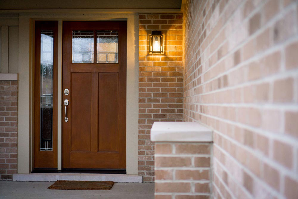 Replace porch lighting and handlesets for added curb appeal.