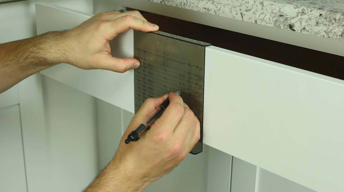 Step 6: Align the drawer template and mark the drill holes. | Cabinet Hardware Installation