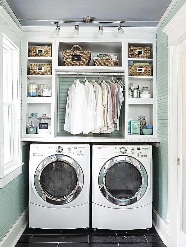 Install a tension rod under laundry room cabinets for extra hanging space. | GreyDock Blog