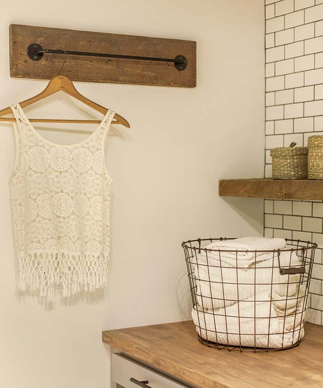 Install a towel bar in your laundry room so you can air-dry freshly washed clothing.