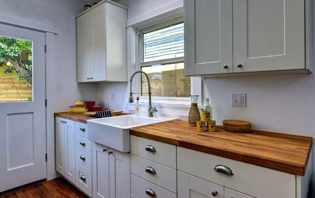 Butcher block countertops in a farmhouse kitchen.