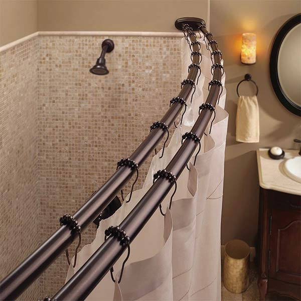 Double curved shower rods add several inches of space to your shower and keep your liner and decorative curtain separate.