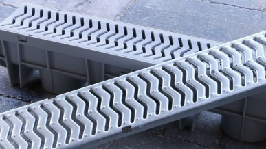 Channel Drain Maintenance: How to Remove the Grate | GreyDock Blog